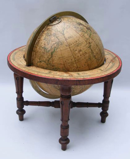 A ten-inch Bardin terrestrial table-globe on mahogany legs dated 1843.