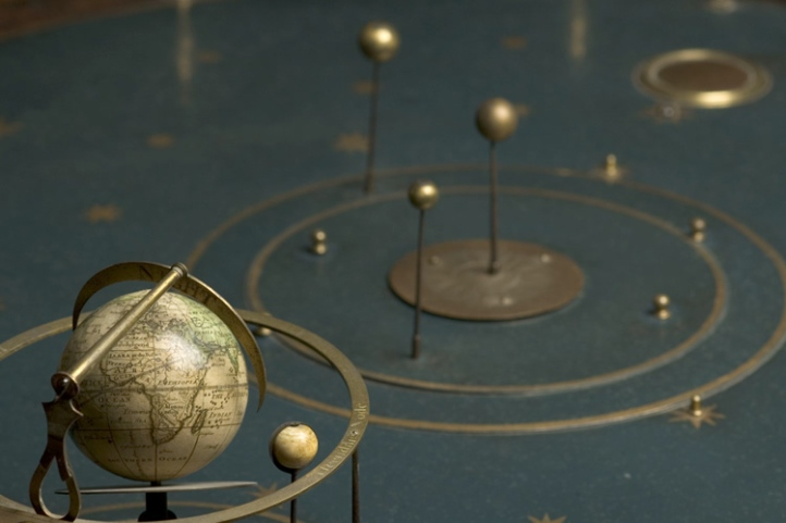 Detail of the orrery above, showing a miniature globe engraved by Wright's neighbour and colleague Richard Cushee (1696-1733).