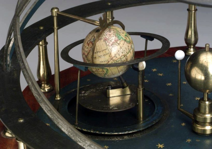 Miniature orrery by Troughton, London with armillary bands and octagonal base, showing three planets including the Earth and Moon with wooden case, late 18th century to early 19th century.