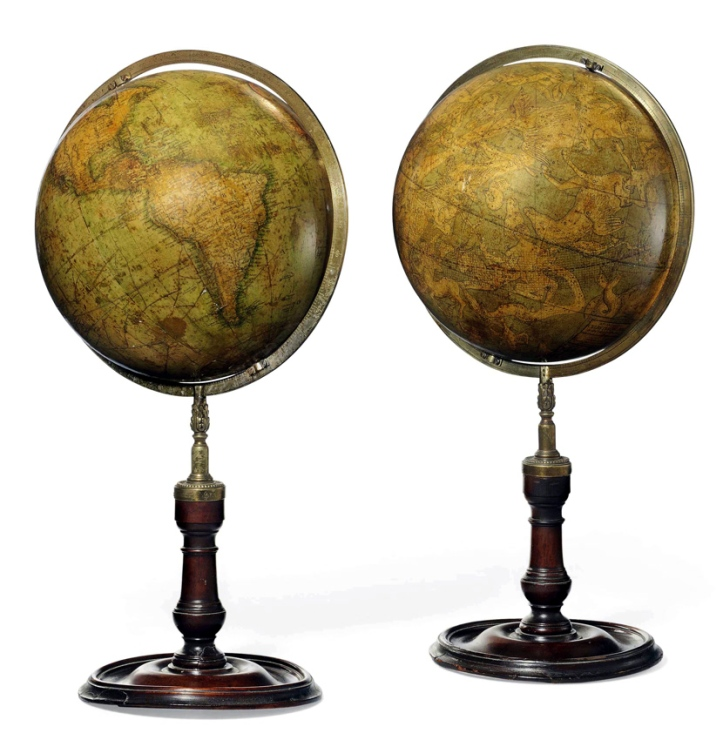 A pair of nine-inch Dudley Adams globes on later wooden stands.