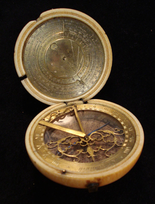 A horizontal compass sundial made of gilt brass by Charles Whitwell.