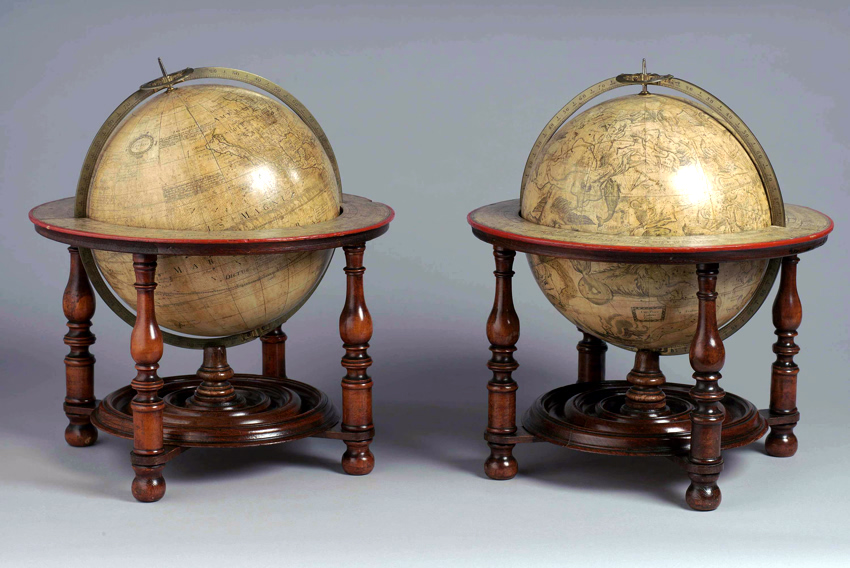 A pair of twelve-inch globes by Charles Price, dated 1715 and bearing the joint imprint of Benjamin Scott.